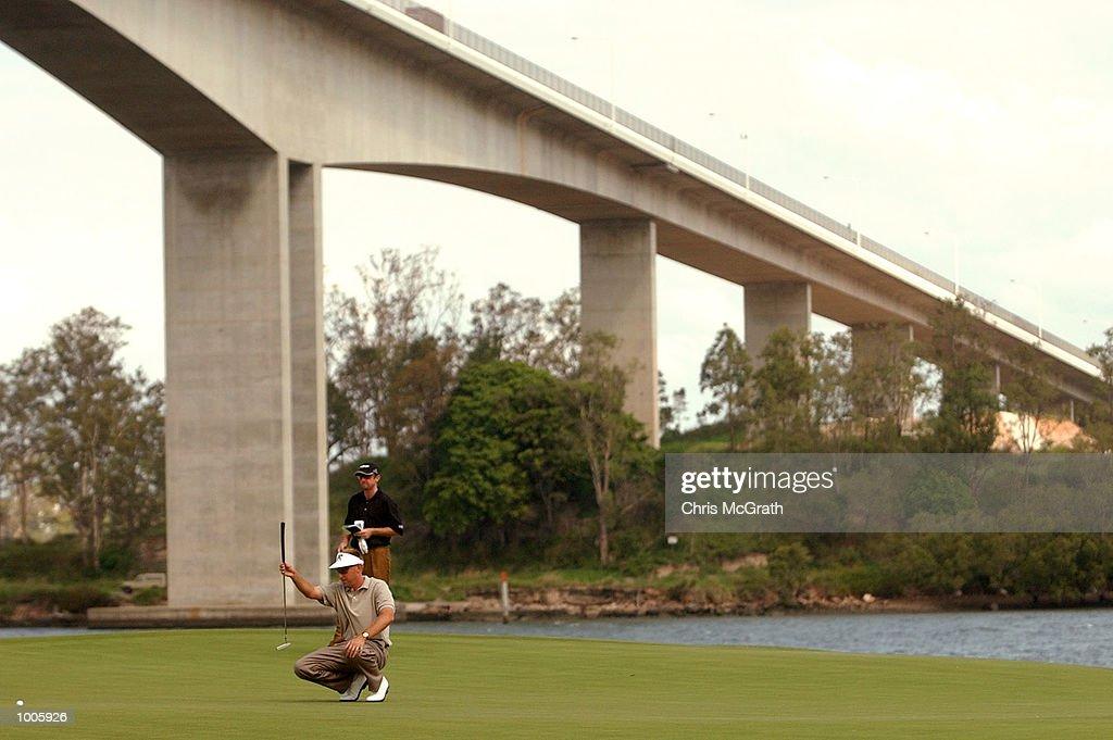 Robert Allenby of Australia lines up a putt under Brisbanes Gateway bridge during the second round of the Australian PGA Championships being played at Royal Queensland Golf Club, Brisbane, Australia. DIGITAL IMAGE Mandatory Credit: ChrisMcGrath/ALLSPORT