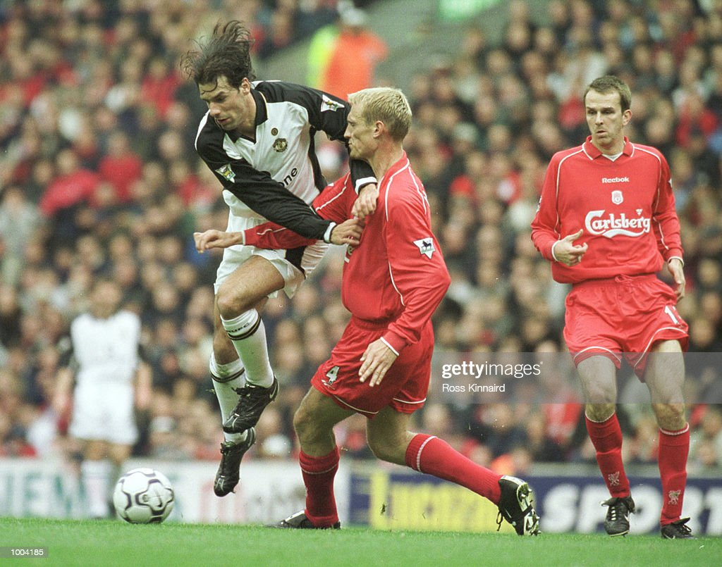 Ruud Van Nistelrooy of Manchester United leaps over Liverpool Captain Sami Hyypia during the FA Barclaycard Premiership game between Liverpool and Manchester United at Anfield, Liverpool. Mandatory Credit: Ross Kinnaird/ALLSPORT