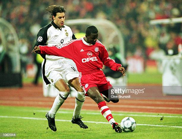 Ruud Van Nistelrooy of Manchester United tries to tackle Samuel Kuffour of Bayern Munich during the UEFA Champions League Group A match between...