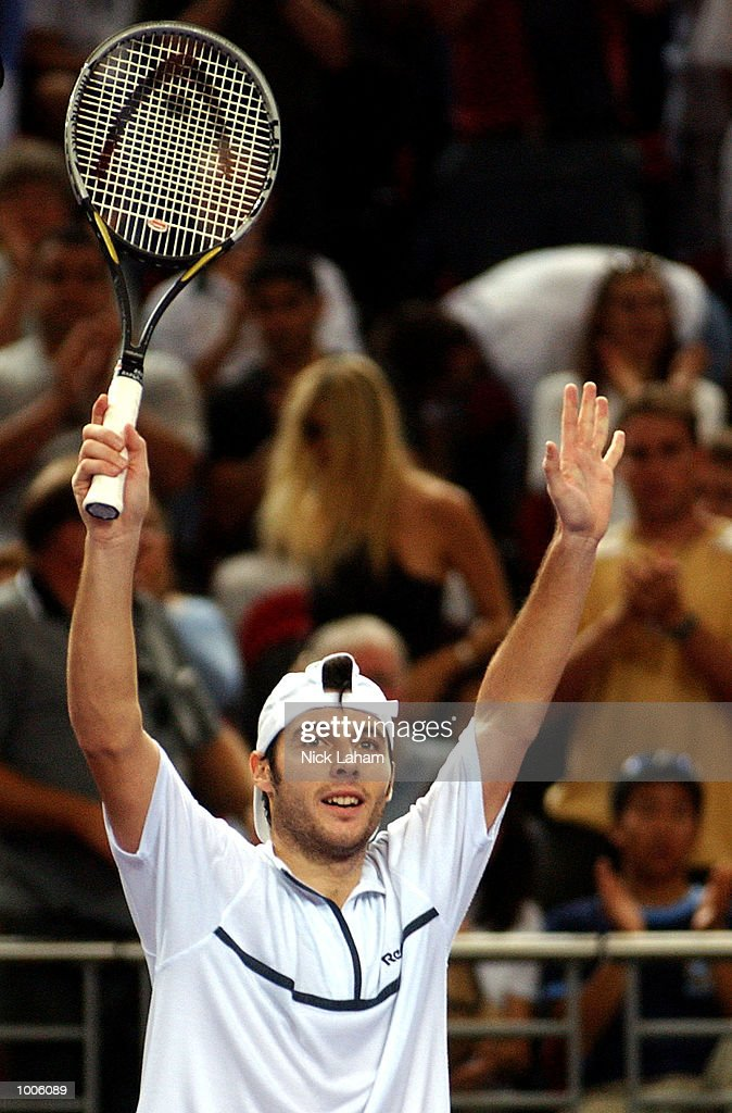 Sebastien Grojean of France celebrates his victory over Yevgeny Kafelnikov of Russia during the semi final of the Tennis Masters Cup held at the Sydney Superdome, Sydney, Australia. DIGITAL IMAGE Mandatory Credit: Nick Laham/ALLSPORT