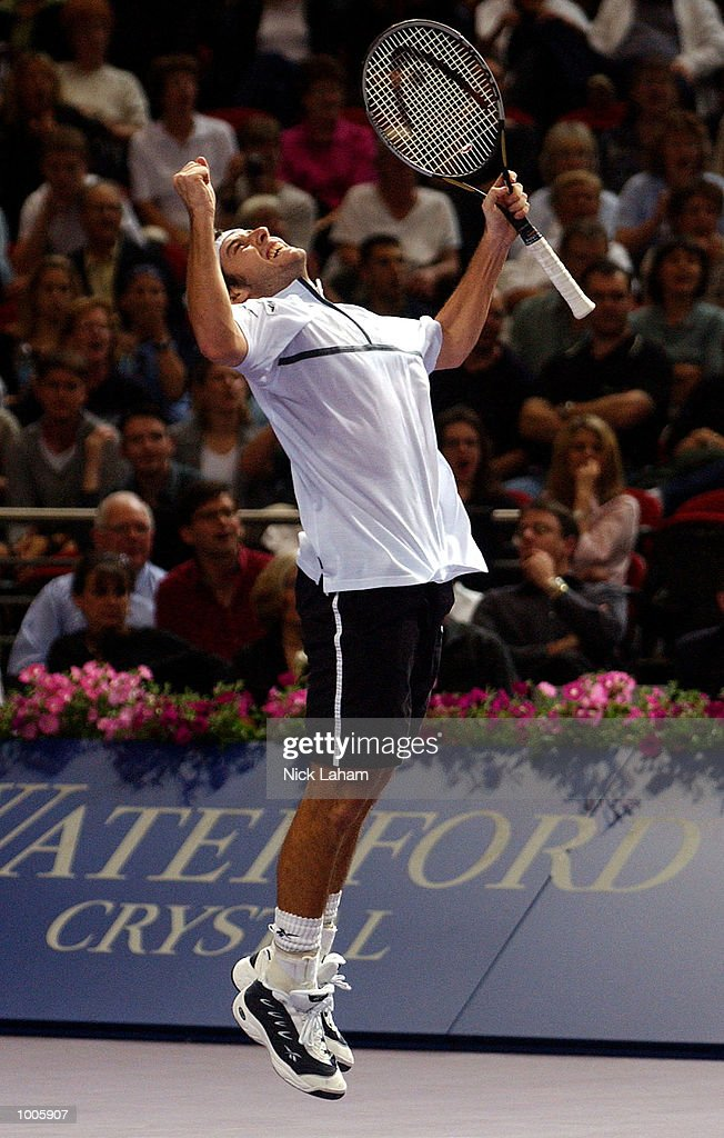 Sebastien Grosjean of France celebrates his victory over Andre Agassi of the United States during the Tennis Masters Cup held at the Sydney Superdome, Sydney, Australia. DIGITAL IMAGE Mandatory Credit: Nick Laham/ALLSPORT