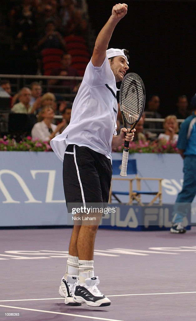 Sebastien Grosjean of France celebrates his victory over Yevgeny Kafelnikov of Russia during the Tennis Masters Cup held at the Sydney Superdome, Sydney, Australia. DIGITAL IMAGE Mandatory Credit: Nick Laham/ALLSPORT
