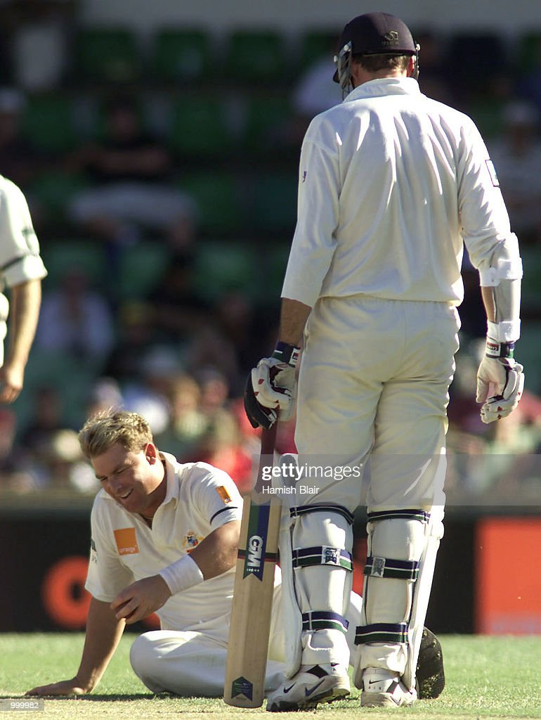Shane Warne of Australia goes to ground in front of Stephen Fleming of New Zealand during day one of the Third Test between Australia and New Zealand played at The WACA, Perth, Australia. DIGITAL IMAGE. Mandatory Credit: Hamish Blair/ALLSPORT