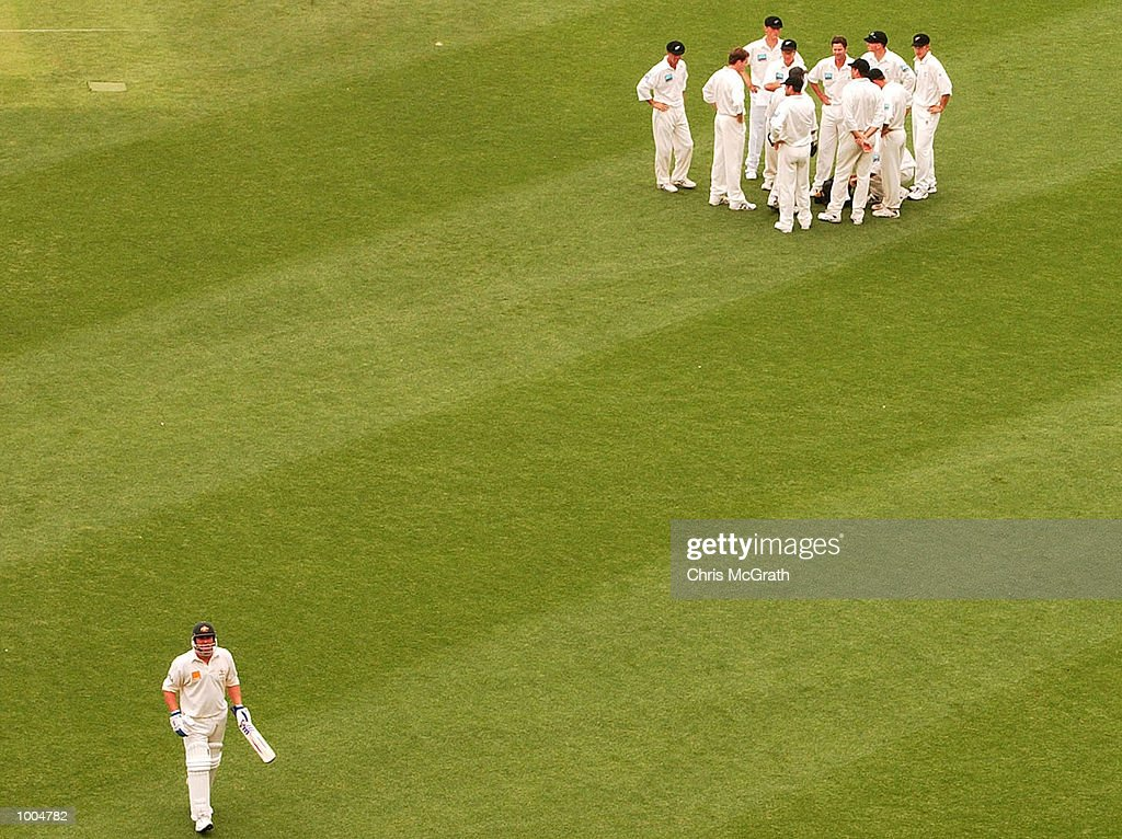 Shane Warne of Australia heads back to the dressing room after being dismissed by Chris Cairns of New Zealand during day two of the first cricket test between Australia and New Zealand held at the Gabba, Brisbane, Australia, DIGITAL IMAGEMandatory Credit: Chris McGrath/ALLSPORT