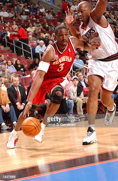 Shareef Abdur-Rahim of the Atlanta Hawks drives baseline on Derrick Coleman of the Philadelphia 76ers during a game at the First Union Center in...