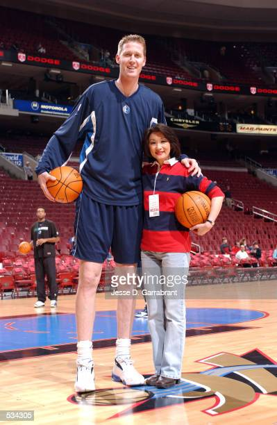 Shawn Bradley of the Dallas Mavericks poses with Connie Chung before the Philadelphia 76ers home opener at the First Union Center in Philadelphia...
