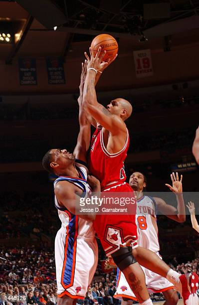 Small forward Marcus Fizer of the Chicago Bulls shoots over Kurt thomas of the New York knicks during their game at Madison Square Garden in New York...