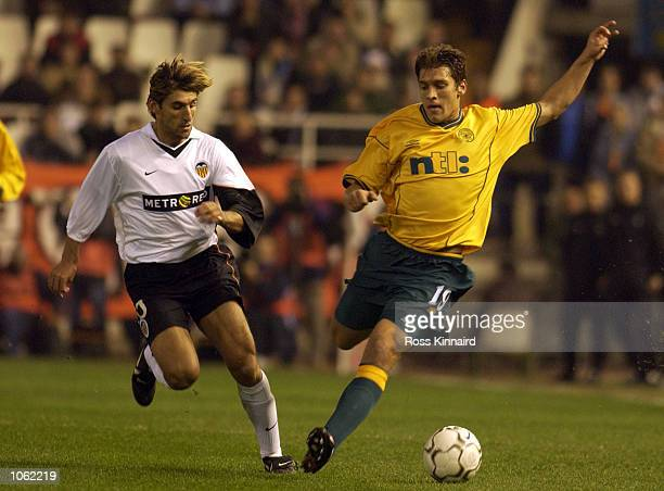Stilian Petrov of Celtic gets away from Angulo of Valencia during the UEFA Cup Third round first leg match between Valencia and Celtic at Stadio...