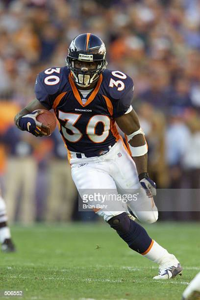 Terrell Davis of the Denver Broncos heads downfield against the San Diego Chargers during the game at Invesco Field at Mile High Stadium in Denver...