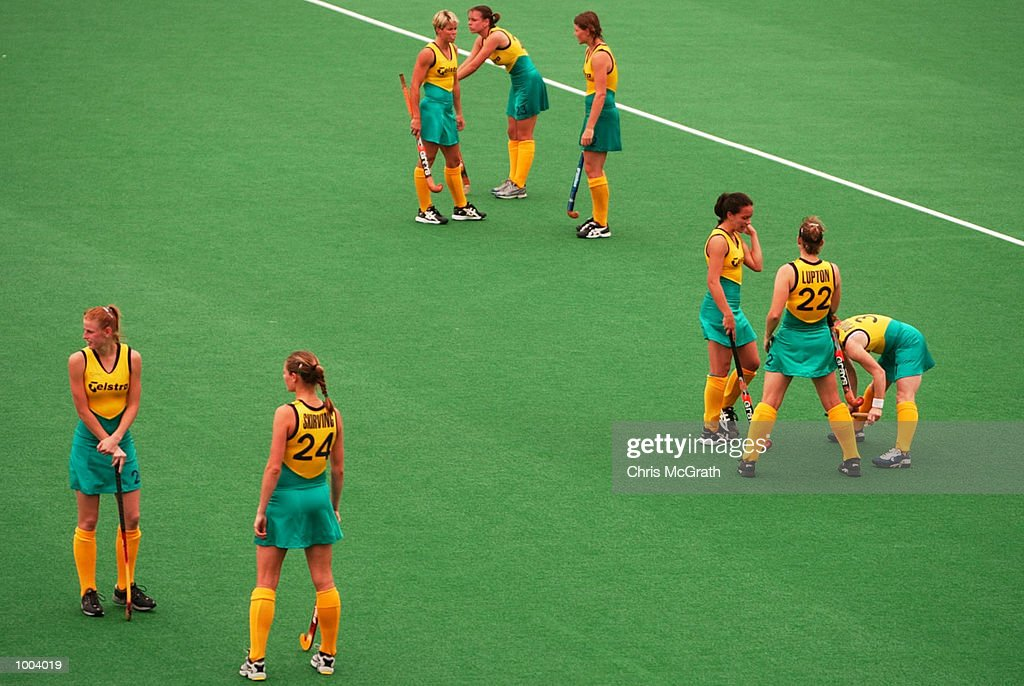 The Hockeyroos wait as water is cleared from the goals after to much watering at half time delayed the start of the second half during the third hockey test match between the Australian Hockeyroos and the New Zealand Black Sticks held at the Sydney Hockey Centre, Homebush Bay, Sydney, Australia. DIGITAL IMAGE Mandatory Credit: Chris McGrath/ALLSPORT