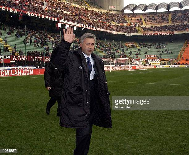 The new AC Milan coach Carlo Ancelotti acknowledges the crowd before his first game in charge of the club The game was the Serie A match between AC...