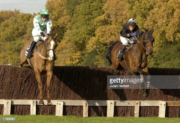 Thierry Doumen and Djeddah clear the final open ditch in company with the JP McNamara ridden Lance Armstrong before going on to win The John Doyle...