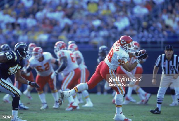 Tight end Tony Gonzalez of the Kansas City Chiefs catches the ball while safety Rogers Beckett of the San Diego Chargers tries to keep up during the...