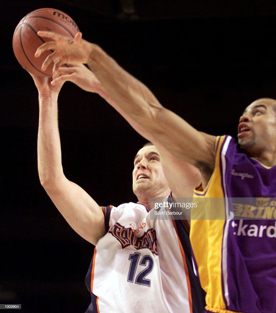 Tony Rampton #12 (left) and Travis Lane #21 of the Kings battle for the ball during the Sydney Kings v Cairns Taipans match held at the Sydney Superdome in Sydney, Australia. DIGITAL IMAGE. Mandatory Credit: Scott Barbour/ALLSPORT