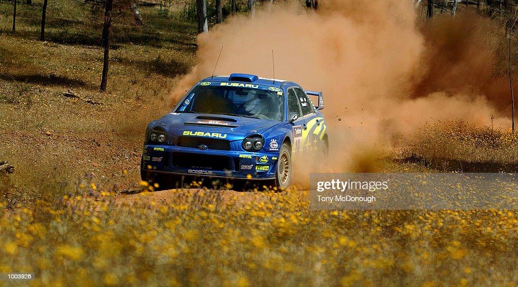 Toshihiro Arai of Japan and co-driver, Glenn MacNeall put their Subaru Impreza WRC 2001 to the test on the outback bush tracks around Mundaring during the 19.98 km Special Stage Flynn's Short of Leg 1 of the Telstra Rally Australia at Perth, Australia. DIGITAL IMAGE Mandatory Credit: Tony McDonough/ALLSPORT