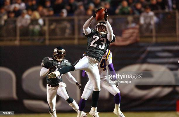 Troy Vincent cornerback for the Philadelphia Eagles goes up to try to intercept a pass intended for Randy Moss wide receiver for the Minnesota...