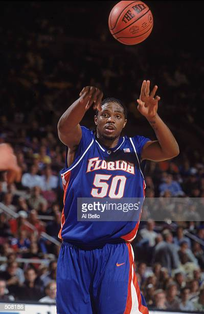 Udonis Haslem of the Florida Gators passes the ball during the IKON Classic against the Arizona Wildcats at Madison Square Garden in New York New...