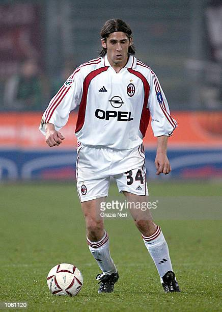 Umit Davala of AC Milan in action during the Serie A 10th Round League match between Torino and AC Milan played at the Delle Alpi Stadium in Turin...