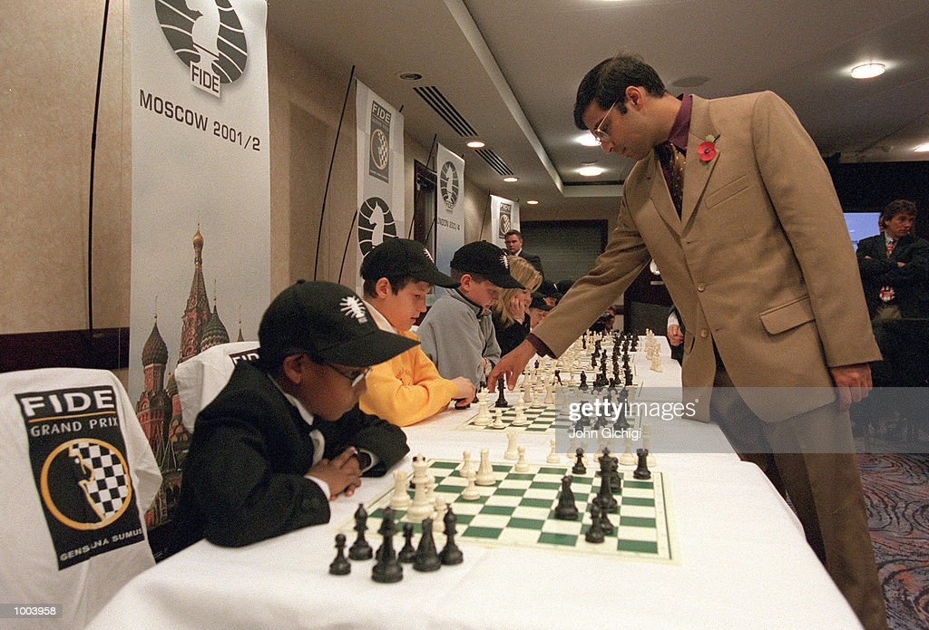 Vishwanathan Anand of India World Chess Champion challenging young chess players simultaneously at the FIDE World Chess Championships Press Conference held at Chelsea Football Club. Mandatory Credit: John Gichigi/ALLSPORT