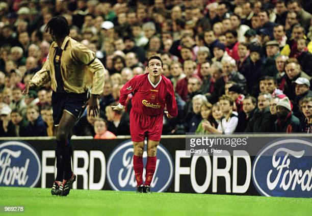 Vladimir Smicer of Liverpool takes a throwin during the UEFA Champions League Group B match against Barcelona played at Anfield in Liverpool England...