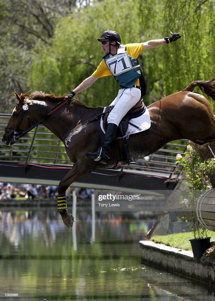 Will Enzinger of Australia on Feurikus takes the water jump one-handed in the cross-country section of the Adelaide International Horse trials held at Victoria Park in Adelaide, Australia. DIGITAL IMAGE. Mandatory Credit: Tony Lewis/ALLSPORT
