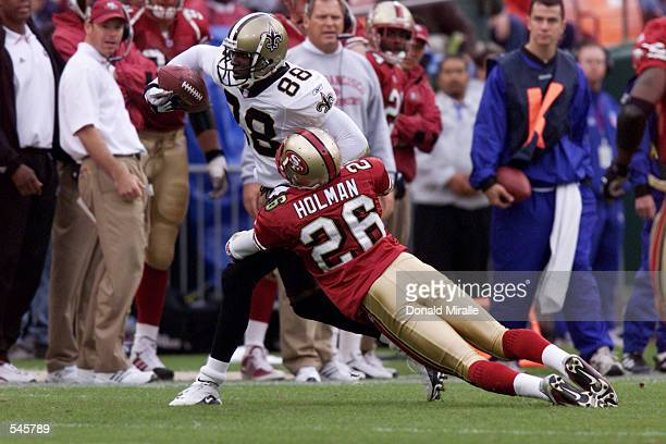 Willie Jackson of the New Orleans Saints runs against the defense Rashad Holman of the San Fransisco 49ers during the game at 3 Com Stadium in San...
