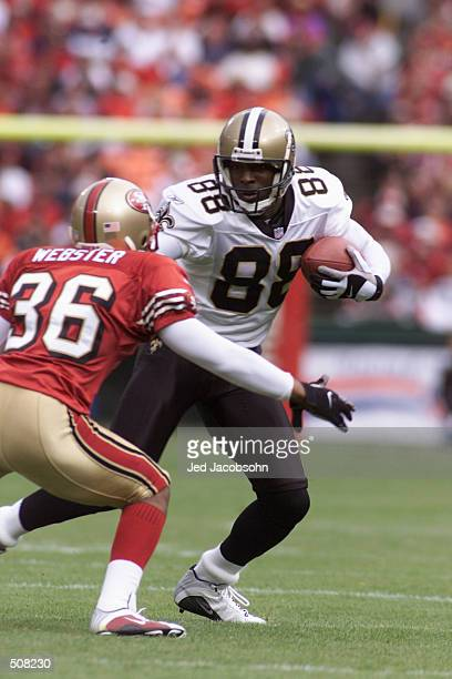 Willie Jackson of the New Orleans Saints tries to get by Jason Webster of the San Francisco 49ers during the game at 3 Com Stadium in San Francisco...