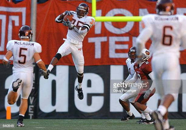 Willie Pile of the Virginia Tech Hokies goes up to make an interception against the Temple Owls as the Hokies defeated the Owls 350 in Big East NCAA...