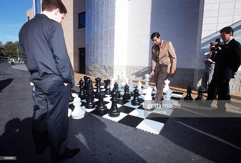 World Champion Vishwanathan Anand of India looked upon by H. E. Kirsan Illyumzhinov (r) president of FIDE at the FIDE World Chess Championships Press Conference held at Chelsea Football Club. Mandatory Credit: John Gichigi/ALLSPORT