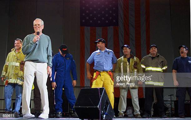 Actor and team owner Paul Newman pays tribute to the Simple Green Safety Team during the Runway Madness CARA Charity event at the Marlboro 500 round...