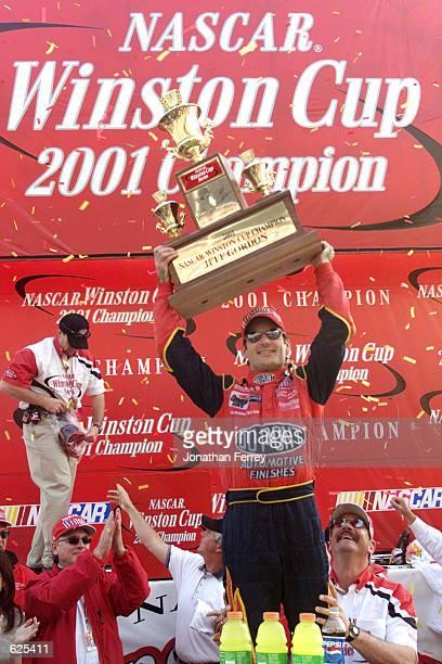 Jeff Gordon celebrates winning the championship at the NASCAR Winston Cup NAPA 500 at the Atlanta Motor Speedway in Hampton, Georgia. Digital Image....