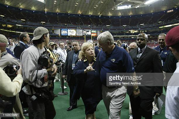 Head coach Mike Martz and owner Georgia Frontiere of the St Louis Rams leave the field after the Rams 4817 victory over the Minnesota Vikings at the...