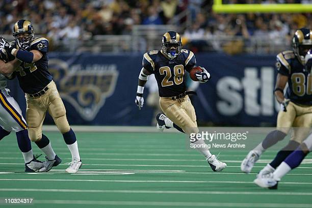 Marshall Faulk of the St Louis Rams during the Rams 4817 victory over the Minnesota Vikings at the Edward Jones Dome in St Louis MO
