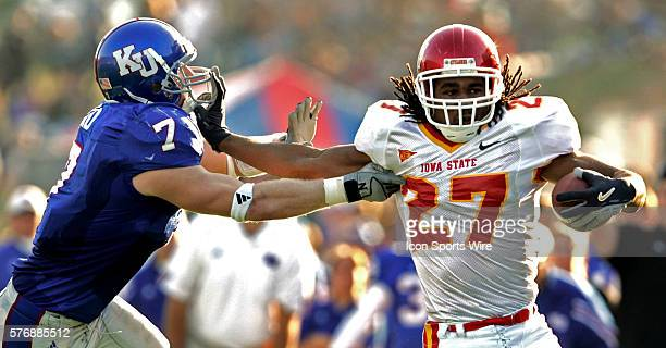 Cyclones player Stevie Hicks pushes off from KU's Nick Reid in the second half of the Kansas Jayhawks overtime win 2421 over the Iowa State Cyclones...