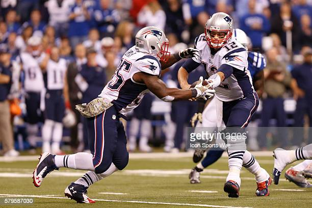 New England Patriots quarterback Tom Brady hands off to New England Patriots running back Jonas Gray during the football game between the New England...