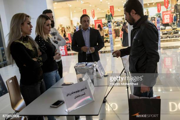 Relatives of earthquake victims of Kermanshah Privence of Iran hold a Campaign for collecting money at Family Mall Erbil the capital of Kurdistan...