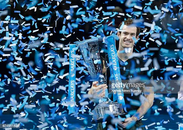 Andy Murray of Britain celebrates with the trophy after winning the men's singles final against Serbia's Novak Djokovic at the 2016 ATP World Tour...