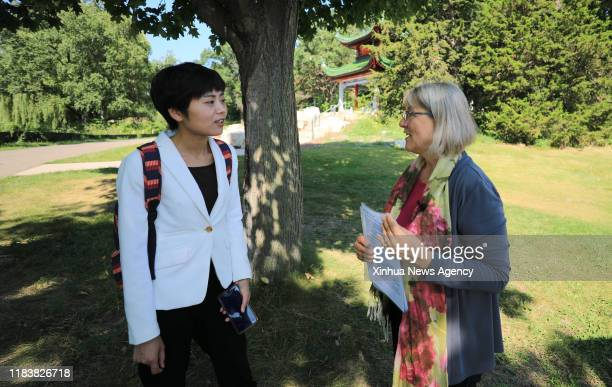 Nov. 21, 2019 -- Linda Mealey-Lohmann R, president of the Minnesota China Friendship Garden Society, is interviewed with Xinhua in the China garden...