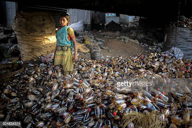 Nov 22 2015 Dhaka Bangladesh Young girl is working in plastic recycle factory Most of them are growing up without any formal education