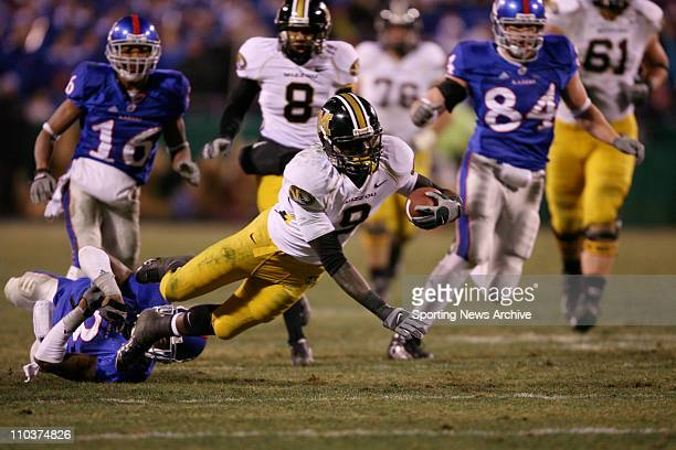Nov 24 2007 Kansas City Missouri USA The Missouri Tigers JEREMY MACLIN dives for a gain against the Kansas Jayhawks at Arrowhead Stadium The Tigers...