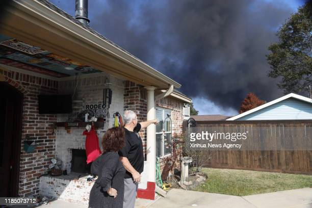 HOUSTON Nov 27 2019 Local people look at smoke from a chemical plant of TPC Group as the fire continues in Port Neches about 150 km east of downtown...