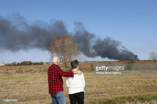 HOUSTON Nov 27 2019 People look at smoke from a chemical plant of TPC Group as the fire continues in Port Neches about 150 km east of downtown...