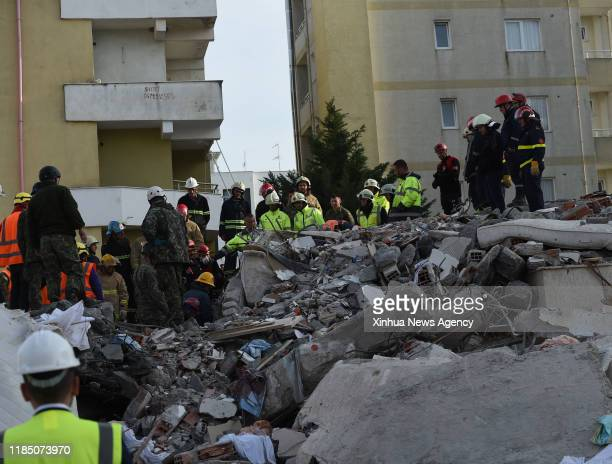 DURRES Nov 27 2019 Rescuers work at the site of a collapsed building in the town of Durres Albania on Nov 27 2019 Some 40 hours after a strong...
