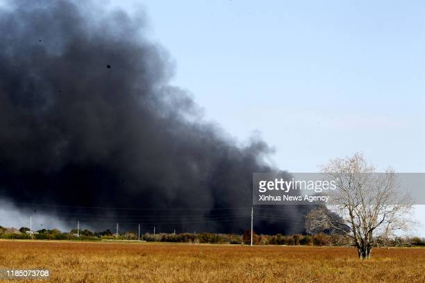 HOUSTON Nov 27 2019 Smoke rises from a chemical plant of TPC Group as the fire continues in Port Neches about 150 km east of downtown Houston Texas...