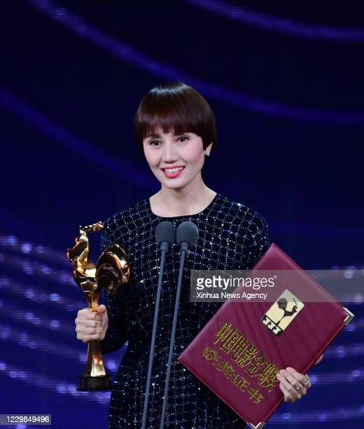 Nov. 28, 2020 -- Yuan Quan is honored with the Best Supporting Actress Award at the awarding ceremony of the 33rd China Film Golden Rooster Awards...