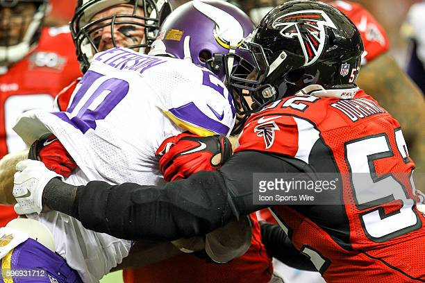 Atlanta Falcons outside linebacker Justin Durant stops Minnesota Vikings running back Adrian Peterson in second half action of the game between the...