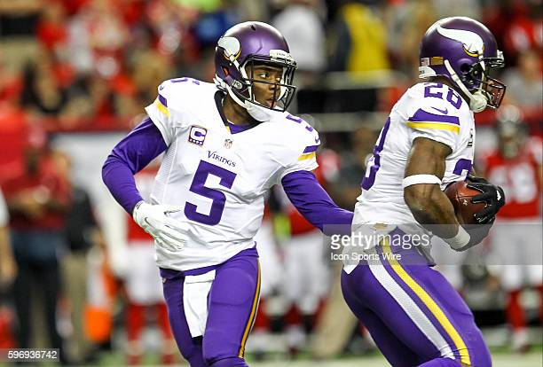 Minnesota Vikings quarterback Teddy Bridgewater hands the ball off to Minnesota Vikings running back Adrian Peterson during the first half of the...