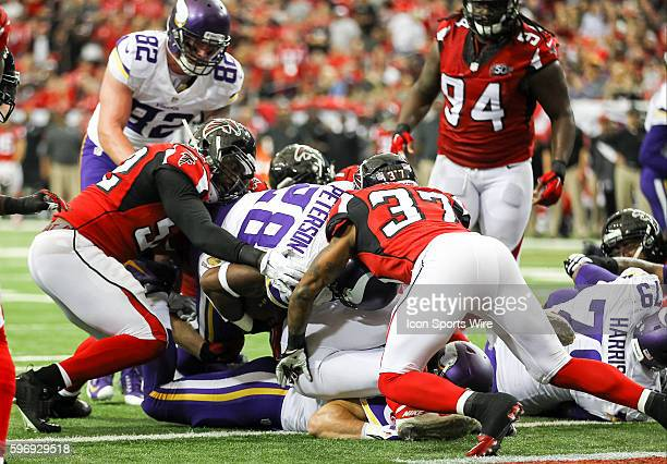 Minnesota Vikings running back Adrian Peterson dives into the end zone for a touchdown during the first half of the game between the Vikings and the...