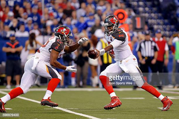 Tampa Bay Buccaneers quarterback Jameis Winston hands off to Tampa Bay Buccaneers running back Doug Martin during the football game between the Tampa...