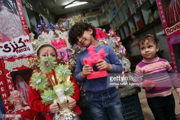 TANTA Nov 3 2019 Children hold traditional candies in a market in Tanta Egypt Nov 3 2019 Shops and stalls of traditional sugar candies with various...